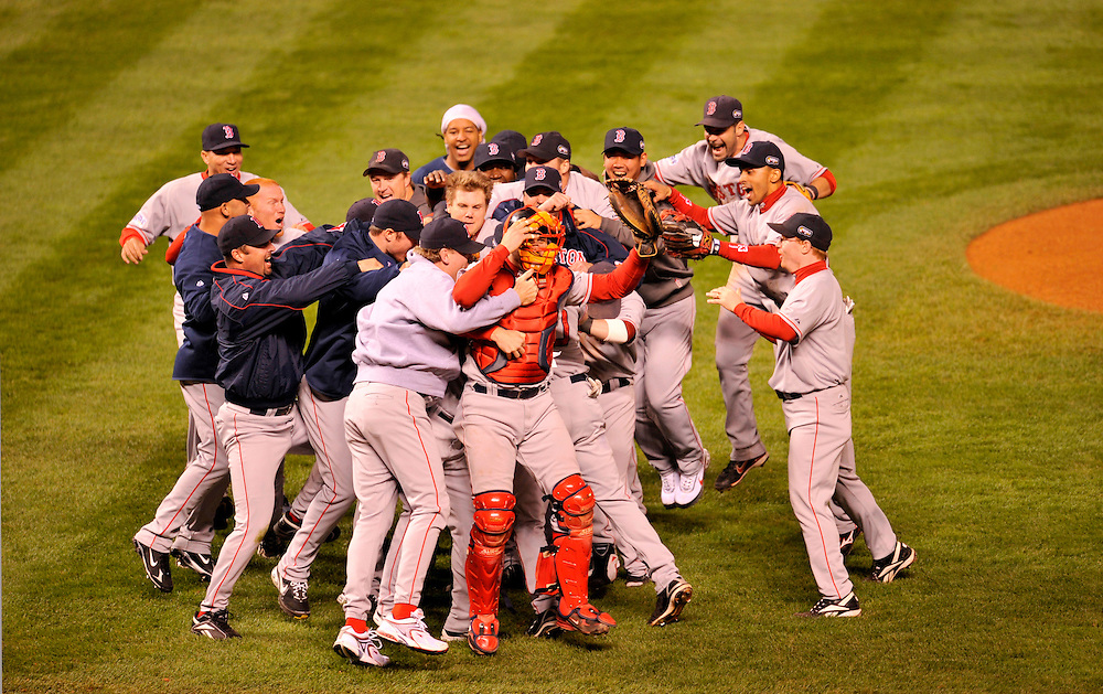 DENVER - OCTOBER 28: Members of the Boston Red Sox rush the field and celebrate after defeating the Colorado Rockies in Game Four of the 2007 Major League Baseball World Series at Coors Field on October 28, 2007 in Denver, Colorado.