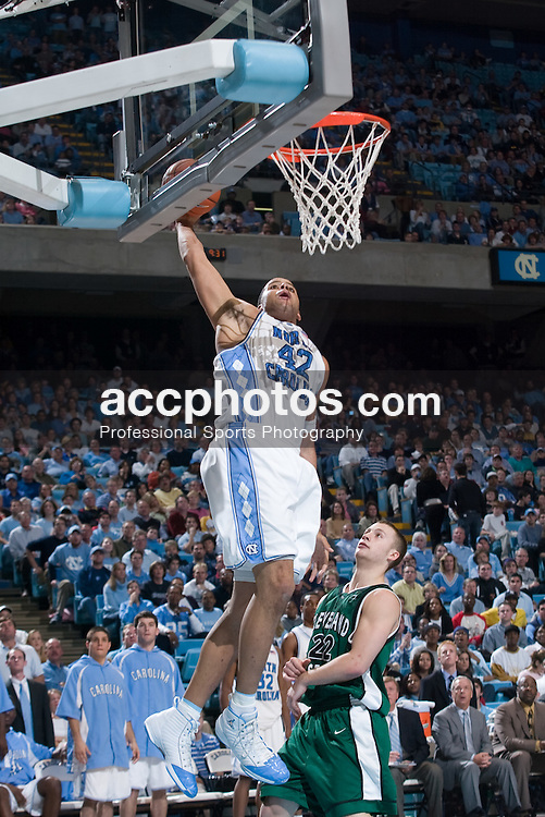 2004 December 30:  North Carolina Tar Heel center Sean May (42) during a 107-64 UNC-Chapel Hill victory over Cleveland State at the Dean Smith Center on the Campus of the University of North Carolina in Chapel Hill, NC.