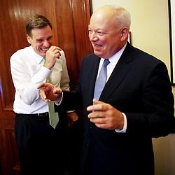 Kyle Green / The Roanoke Times<br /> 6/27/2012 Senator Mark Warner jokes with Norfolk Mayor Paul D. Fraim (right) after a meeting in Warner's office in The Russell Senate Office Building in Washington, D.C.