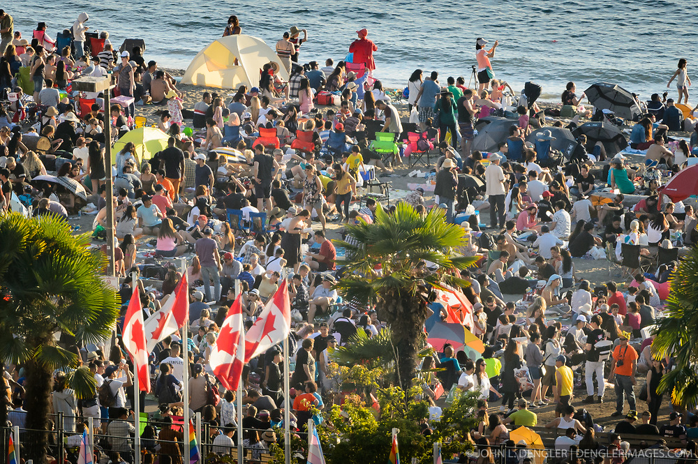 People pack the beach at English Bay Beach Park prior to the Honda Celebration of Light fireworks program in Vancouver, British Columbia