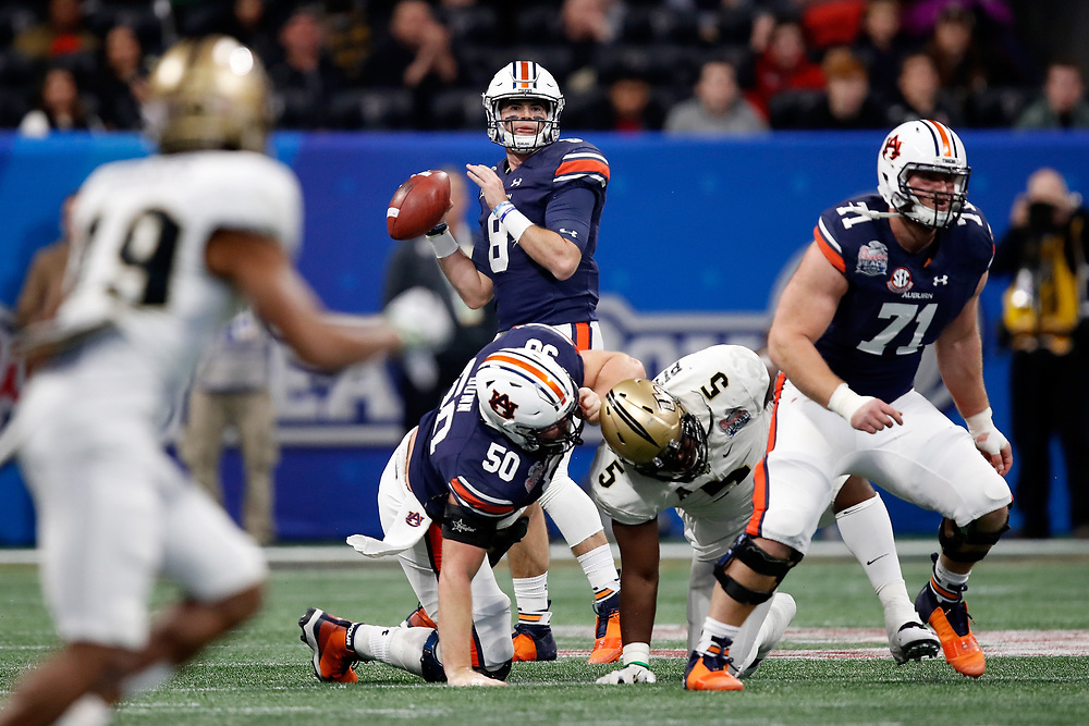 Auburn Tigers quarterback Jarrett Stidham (8) drops back to pass during the 2018 Chick-fil-A Peach Bowl NCAA football game against the UCF Knights on Monday, January 1, 2018 in Atlanta. (Paul Abell / Abell Images for the Chick-fil-A Peach Bowl)