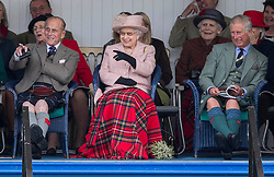 Braemar Highland Gathering.<br /> <br /> Picture shows: The Queen attends the Braemar Games in Scotland, United Kingdom. accompanied by The Duke of Edinburgh and Prince Charles. Saturday, 7th September 2013. Picture by i-Images