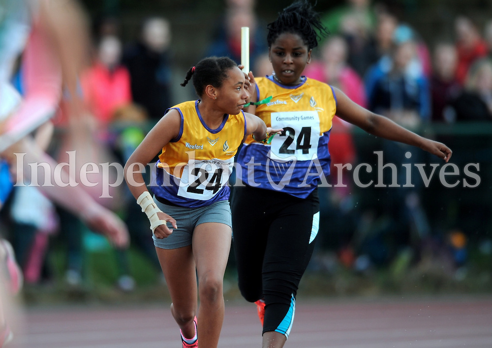 20 Aug 2016: Precious Obasahan, right, Wexford, hands the baton to Ciara O'Connor who runs the final leg of Girls U14 4x100 Relay.   2016 Community Games National Festival 2016.  Athlone Institute of Technology, Athlone, Co. Westmeath. Picture: Caroline Quinn