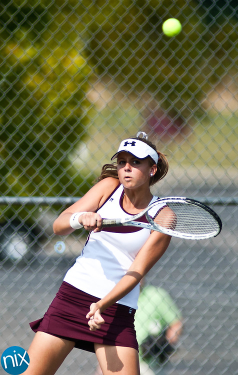 Jay M. Robinson's Alyssa Holden returns a shot during a match against Northwest Cabarrus' Vicki DiRenzi Monday afternoon in Concord. (Photo by James Nix)