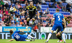 WIGAN, ENGLAND - Sunday, August 19, 2012: Chelsea's Frank Lampard in action against Wigan Athletic's James McArthur during the Premiership match at the DW Stadium. (Pic by Vegard Grott/Propaganda)