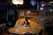 A man plays solitaire at a bar on Wednesday, November 30, 2011 in Webster City, IA.