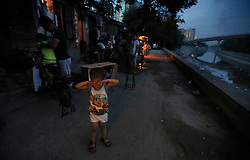 A picture made available on 30 July 2013 of Chinese boy crying as he walks along a canal in a slum or shanty town area by the second ring road of Beijing, a few hundred metres away from the prosperous Central Business District (CBD), separated only by a busy highway in China, 29 July 2013. Beijing announced plans to spend 500 billion yuan (61.5 billion euros) to renovate shanty towns within the fourth ring road according to local media. The five-year plan is expected to affect more than 230,000 households. China's massive urbanization push has resulted in the creation of large pockets of shanty towns and slums in urban areas as millions of migrant workers shifting to the cities are often priced out of city-centre properties. Slum or shanty town dwellers often live in dirty and cramped conditions, where they have no running water in their homes and have to share toilet and shower facilities.