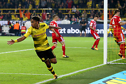 DORTMUND, Aug. 6, 2017  Dortmund's Pierre-Emerick Aubameyang (front) celebrates scoring during the 2017 German Super Cup match between Bayern Munich and Borussia Dortmund in Dortmund, Germany, on Aug. 5, 2017. Bayern Munich won 7-6 after penalty shootout and got the 2017 German Super Cup trophy. (Credit Image: © Joachim Bywaletz/Xinhua via ZUMA Wire)