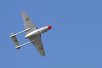 A DeHavilland Vampire shows its underside during an aerobatic display