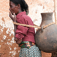 Women carry heavy clay pots to fetch water when water flows in the streams. This creates many health issues such as prolapse conditions.