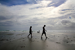 NEW ZEALAND PIHA BEACH 12DEC07 - Walkers on Piha Beach, West Coast of northern Island, New Zealand...jre/Photo by Jiri Rezac..© Jiri Rezac 2007..Contact: +44 (0) 7050 110 417.Mobile:  +44 (0) 7801 337 683.Office:  +44 (0) 20 8968 9635..Email:   jiri@jirirezac.com.Web:    www.jirirezac.com..© All images Jiri Rezac 2007 - All rights reserved.