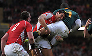 Photo © TOM DWYER / SECONDS LEFT IMAGES 2010 - Rugby Union - Invesco Perpetual Series - Wales v South Africa - 13/11/10 - Wales' James Hook lifts South Africa's Bryan Habana in the tackle forcing him to pass the ball - at Millennium Stadium Cardiff Wales UK -  All rights reserved