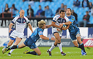 PRETORIA, South Africa, 14 May 2011. Afusipa Taumoepeau of the Melbourne Rebels is tackled by Wynand Olivier and Stephan Dippenaar of the Bulls during the Super15 Rugby match between the Bulls and the Melbourne Rebels at Loftus Versfeld in Pretoria, South Africa on 14 May 2011..Photographer : Anton de Villiers / SPORTZPICS
