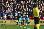 Sheffield Wednesday players celebrate Aiden McGeady's goal during the Sky Bet Championship match between Nottingham Forest and Sheffield Wednesday at the City Ground, Nottingham, England on 12 March 2016. Photo by Jon Hobley.