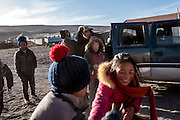Parents come to pick up their children from the school community of Ngam-nak, Tibet (Qinghai, China). Ngam-nak serves as a school for Tibetan nomadic children, who are dropped off by their parents and spend 8 months a year in the remote settlement until they have completed a basic level of education. Staffed by a handful of teachers and cooks, there are no other activities in Ngam-nak apart from the school.