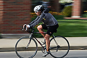Alexandra Murray bikes during the O'Bleness Race for a Reason Triathlon Saturday, April 27, 2013. The triathlon included a 500mm Serpentine Swim at the Ohio University Aquatic Center, a 15 mile bike ride to the Plains and back and then a 5k run that finished at Tailgreat Park across from Peden Stadium. Race for a Reason, Race 4 A Reason, Annual Events, Events, Students, Faculty & Staff