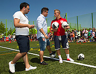 Swiss soccer player Xherdan SHAQIRI of FC Bayern Muenchen, his brother and consultant Erdin (C) and his consultant Arber Sakiri (L) are pictured during a training session for kids at the Coca-Cola Junior League tournament in Zurich, Switzerland, Saturday, June 16, 2012. (Photo by Patrick B. Kraemer / MAGICPBK)
