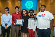 Houston ISD Board of Trustees president Juliet Stipeche, center, poses for a photograph with members off the HISD Student Congress during the Board of Education meeting, October 9, 2014.