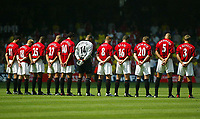 Photograph: Scott Heavey.<br />FA Community Shield fomr the Millenium Stadium in Cardiff. 10/08/2003.<br />The Man Utd team observe a minutes silence in memory of Jimmy Davis.