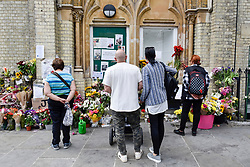 © Licensed to London News Pictures. 23/06/2017. London, UK. Floral tributes and message of condolence are seen in a nearby church.  Nine days on, police have reported that the Grenfell Tower fire in west London started in a fridge-freezer, and outside cladding and insulation failed safety tests. Photo credit : Stephen Chung/LNP
