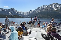 Passengers on deck of MS Dixie II, paddle steamer, as it departs Emerald Bar on the West shore for its permanent mooring in Zephyr Cove, Nevada, USA. The vessel is the largest operating on South Lake Tahoe. The lake itself is split vertically between Nevada in the East and California in the West. It traverses the lake from Zephyr Cove to Emerald Bay in California. The snow-capped mountains are in California. 201304261889<br /> <br /> Copyright Image from Victor Patterson, 54 Dorchester Park, Belfast, UK, BT9 6RJ<br /> <br /> Tel: +44 28 9066 1296<br /> Mob: +44 7802 353836<br /> Voicemail +44 20 8816 7153<br /> Skype: victorpattersonbelfast<br /> Email: victorpatterson@me.com<br /> Email: victorpatterson@ireland.com (back-up)<br /> <br /> IMPORTANT: If you wish to use this image or any other of my images please go to www.victorpatterson.com and click on the Terms & Conditions. Then contact me by email or phone with the reference number(s) of the image(s) concerned.