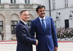 May 5, 2017 - Warsaw, Poland - Polish President Andrzej Duda (L) and the Emir of Qatar (R), Sheikh Tamim bin Hamad Al Thani shake hands during the Emir's official visit to Poland on May 05 2017. The Emir was welcomed by President Duda during the official welcoming ceremony in the Presidential Palace, in Warsaw, Poland. (Credit Image: © Anna Ferensowicz/Pacific Press via ZUMA Wire)