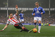 Sunderland defender Sebastian Coates tackles Everton forward Gerard Deulofeu during the Barclays Premier League match between Everton and Sunderland at Goodison Park, Liverpool, England on 1 November 2015. Photo by Simon Davies.