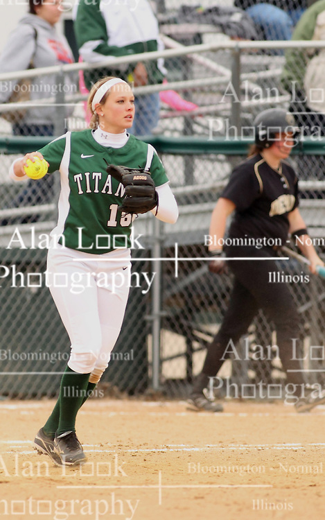 30 March 2013:  Hannah Bowen covers 1st base during an NCAA Division III women's softball game between the DePauw Tigers and the Illinois Wesleyan Titans in Bloomington IL