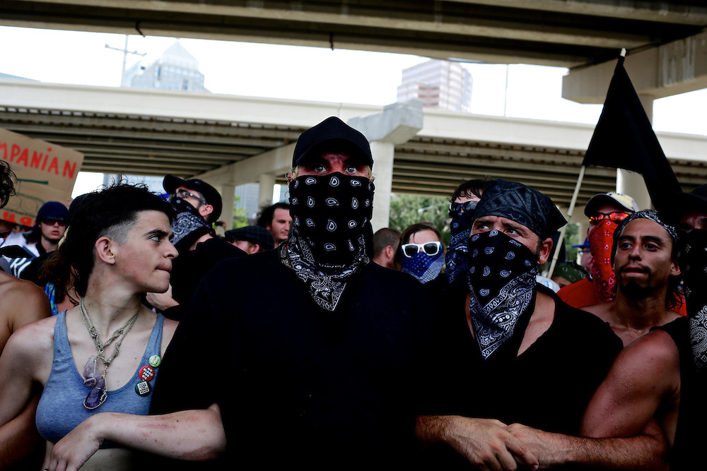 Protestors lock arms as they march through the streets during the 2012 Republican National Convention in Tampa, Fla. on Aug. 28, 2012. Photo by Greg Kahn