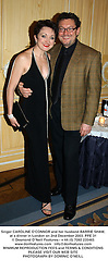 Singer CAROLINE O'CONNOR and her husband BARRIE SHAW, at a dinner in London on 2nd December 2003.PPE 31