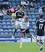 Dundee's James McPake out jumps Raith's Mark Stewart - Raith Rovers v Dundee, pre-season friendly at Starks Park<br /> <br />  - &copy; David Young - www.davidyoungphoto.co.uk - email: davidyoungphoto@gmail.com