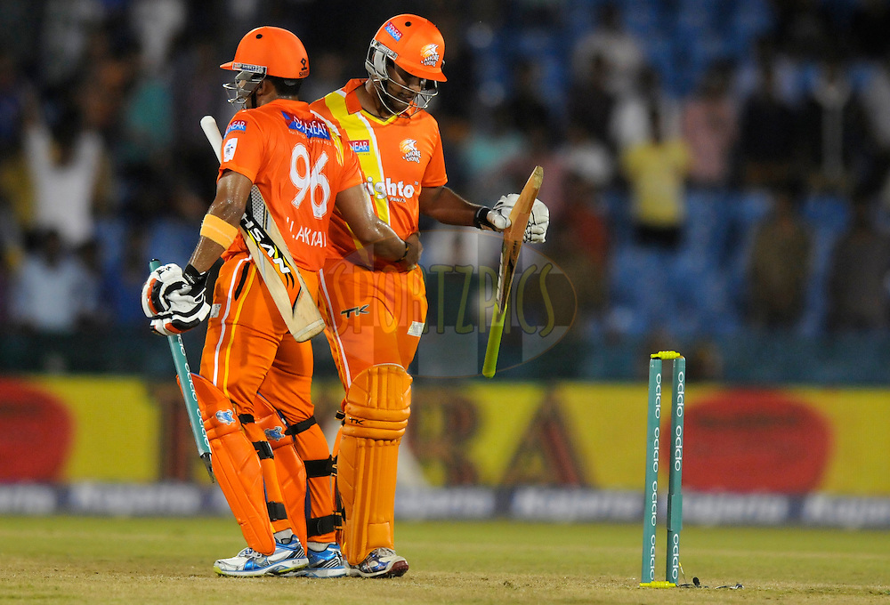 Umar Akmal of Lahore Lions celebrates after hitting the winning shot during the qualifier 2 match of the Oppo Champions League Twenty20 between the Mumbai Indians and the Lahore Lions held at the Chhattisgarh International Cricket Stadium, Raipur, India on the 13th September 2014<br /> <br /> Photo by:  Pal Pillai / Sportzpics/ CLT20<br /> <br /> <br /> Image use is subject to the terms and conditions as laid out by the BCCI/ CLT20.  The terms and conditions can be downloaded here:<br /> <br /> <br /> http://sportzpics.photoshelter.com/gallery/CLT20-Image-Terms-and-Conditions-2014/G0000IfNJn535VPU/C0000QhhKadWcjYs