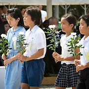 NAGASAKI, JAPAN - AUGUST 9 : Youth representatives lays flowers to the atomic bomb victims in front of the Peace Statue in Nagasaki Peace Park, Nagasaki, southern Japan, Tuesday, August 9, 2016. Japan marked the 71st anniversary of the atomic bombing on Nagasaki. On August 9, 1945, during World War II, the United States dropped the second Atomic bomb on Nagasaki city, killing an estimated 40,000 people which ended World War II. (Photo by Richard Atrero de Guzman/NURPhoto)