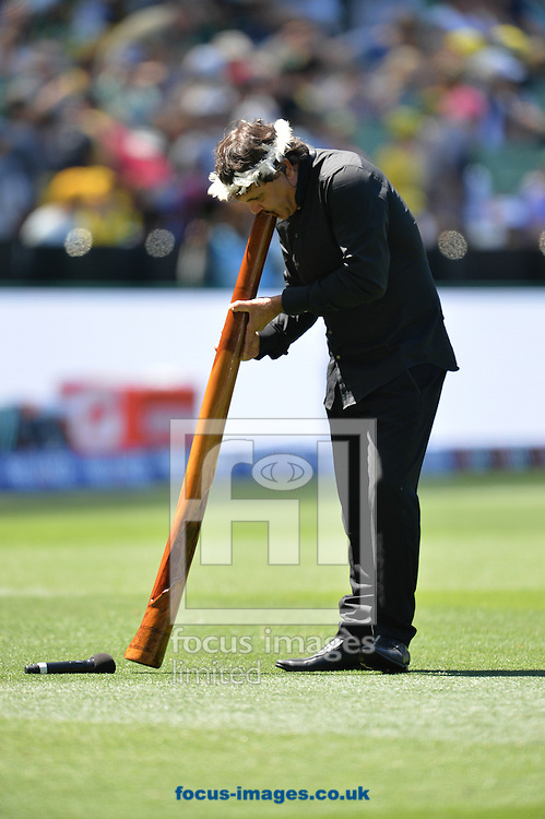 A didgeredoo is played prior to the 2015 ICC Cricket World Cup match at Melbourne Cricket Ground, Melbourne<br /> Picture by Frank Khamees/Focus Images Ltd +61 431 119 134<br /> 14/02/2015
