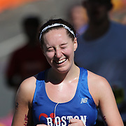 The Finish Line. Expressions of agony and ecstasy on the faces of athletes as Kayla Monks, New York, finishes the ING Hartford Marathon, Bushnell Park, Hartford. Connecticut. USA. Hartford, Connecticut, USA. 12th October 2013. Photo Tim Clayton