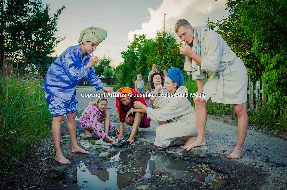 Friends Take Funny Pothole Photos to Draw Governments attention to poor Road Conditions in Kaunas<br /> <br /> A creative and active group of friends (called Z999) decided to draw people&rsquo;s attention to the very poor condition of Lithuanian roads by creating a photo shoot around potholes in Kaunas.<br /> <br /> The aim of this was to laugh at the absurdity of this situation and to draw our government&rsquo;s attention to it so that they might take action and repair our roads. Two professional photographers, Arturas Artiusenka and Eurika Balciute, attended this fun photo shoot.<br /> <br /> None of the photos were made to offend our government; it was just a fun way to express Lithuanian citizens&rsquo; thoughts.<br /> <br /> Let&rsquo;s hope that the condition of our roads gets better next year!<br /> &copy;Arturas Artiusenka/Exclusivepix Media