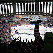 New Jersey Devils fans celebrate a goal during the New York Rangers Vs New Jersey Devils NHL regular season game held outdoors at Yankee Stadium, The Bronx, New York, USA. 26th January 2014. Photo Tim Clayton