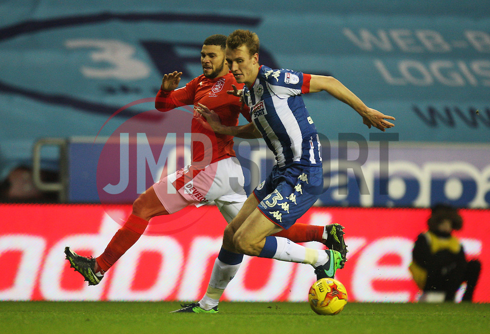 Nahki Wells of Huddersfield Town (L) and Dan Burn of Wigan Athletic in action - Mandatory by-line: Jack Phillips/JMP - 02/01/2017 - FOOTBALL - DW Stadium - Wigan, England - Wigan Athletic v Huddersfield Town - Football League Championship