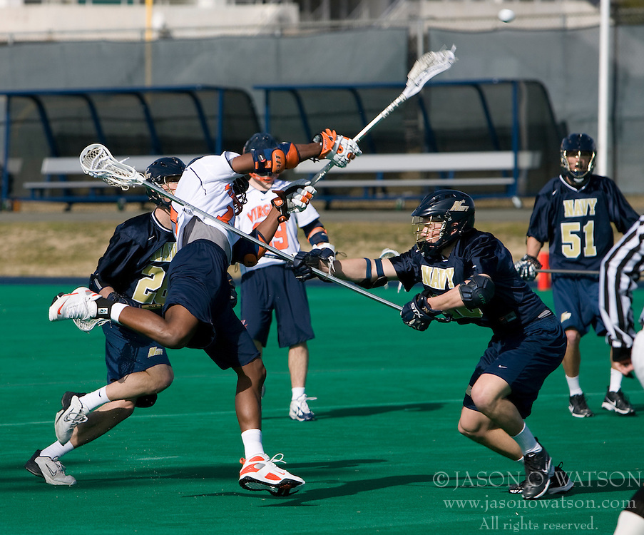 Virginia midfielder Shamel Bratton (1) gets a shot off against Navy.  The Virginia Cavaliers scrimmaged the Navy Midshipmen in lacrosse at the University Hall Turf Field  in Charlottesville, VA on February 2, 2008.
