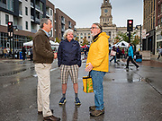 19 OCTOBER 2019 - DES MOINES, IOWA: MARK SANFORD (R-SC), left, talks to visitors to the Des Moines Farmers' Market during a campaign visit to the market Saturday. Sanford, a former Republican governor and Congressman from South Carolina, is challenging incumbent President Donald Trump for the Republican nomination for the US presidency. Iowa hosts the first event of the presidential selection cycle. The Iowa Caucuses are scheduled for February 3, 2020.              PHOTO BY JACK KURTZ