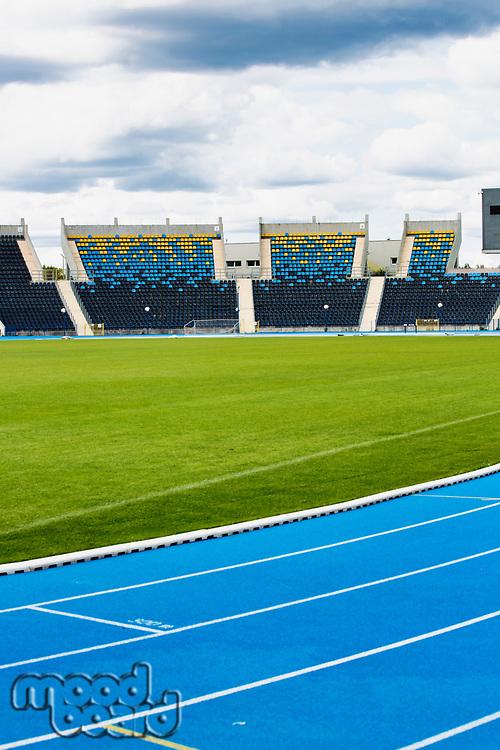 Photo of blue tracking field on stadium