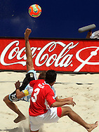 Football - FIFA Beach Soccer World Cup 2006 - Quarter Final - ARG X URU  - Rio de Janeiro - Brazil 09/11/2006<br />Ezequiel Hilaire (ARG) performs a scissors-kick next to Ricar (URU) during the match - Event Title Board Mandatory Credit: FIFA / Ricardo Moraes