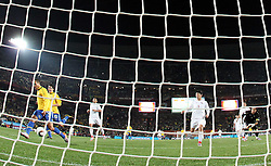 Luis Fabiano (9) of Brazil scores second goal vs goalkeeper of Chile Claudio Bravo (R) during the 2010 FIFA World Cup South Africa Round of Sixteen match between Brazil and Chile at Ellis Park Stadium on June 28, 2010 in Johannesburg, South Africa.  (Photo by Vid Ponikvar / Sportida)