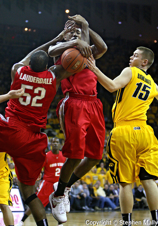 January 27, 2010: Ohio State forward Dallas Lauderdale (52), Ohio State guard/forward David Lighty (23), and Iowa guard Devan Bawinkel (15) battle for a rebound during the first half of their game at Carver-Hawkeye Arena in Iowa City, Iowa on January 27, 2010. Ohio State defeated Iowa 65-57.
