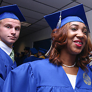 Alexis I. duPont High School graduate Ameena Stevenson, RIGHT, prepare to participate in a graduation processional during duPont High School commencement exercise Saturday, June 06, 2015, at The Bob Carpenter Sports Convocation Center in Newark, Delaware.