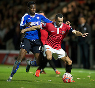 Jerome Wright of FC United of Manchester (right) holds off Gboly Ariyibi of Chesterfield (left) during the FA Cup match at Broadhurst Park, Moston<br /> Picture by Russell Hart/Focus Images Ltd 07791 688 420<br /> 09/11/2015