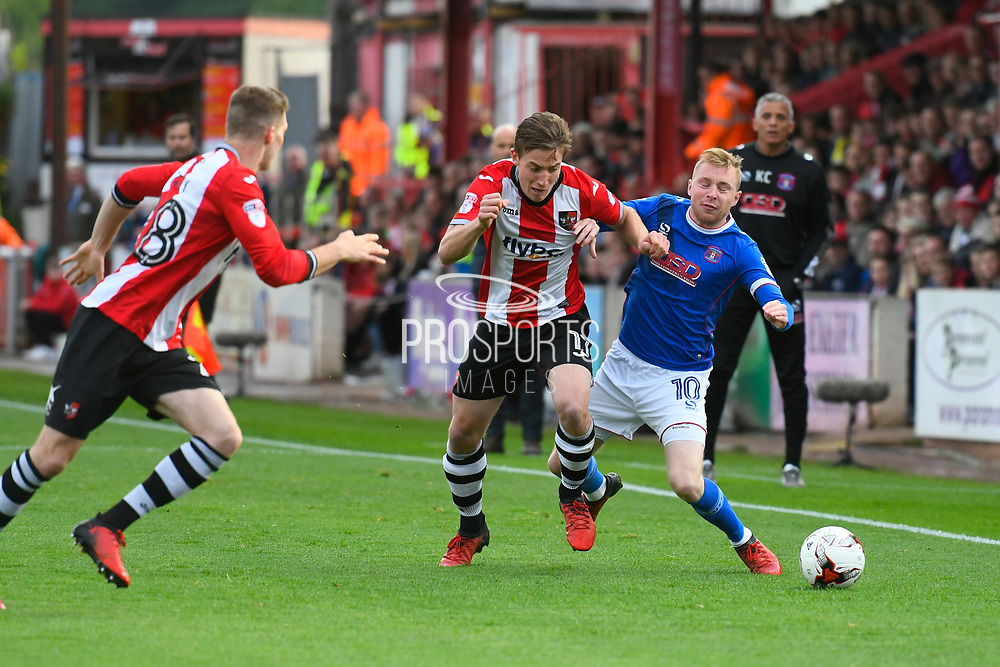 David Wheeler (11) of Exeter City battles for possession with Nicky Adams (10) of Carlisle United during the EFL Sky Bet League 2 play off second leg match between Exeter City and Carlisle United at St James' Park, Exeter, England on 18 May 2017. Photo by Graham Hunt.