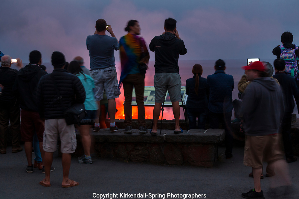 HI00248-00...HAWAI'I - People viewing the lava glowing in the Halema'uma'u Crater from the Jaggar Museum in Volcanoes National Park on the island of Hawai'i.