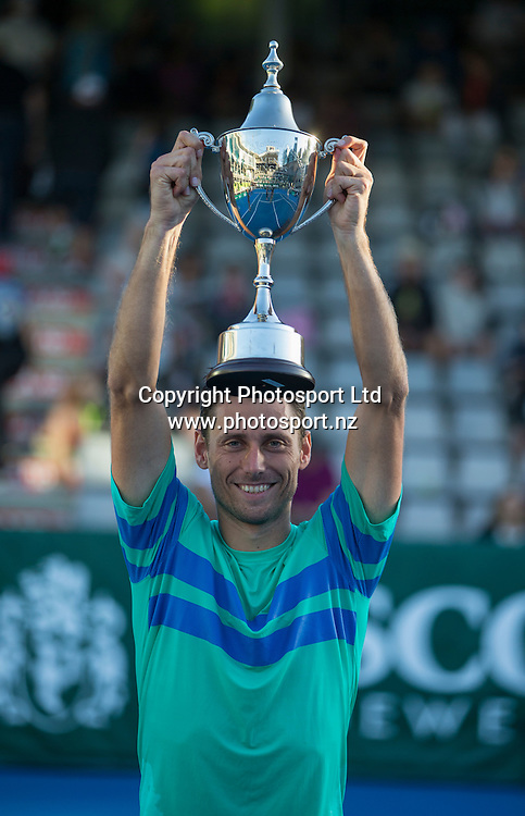 Artem Sitak holds aloft the trophy for winning the mens singles final in the Pascoes NZ Tennis Champs held at the ASB Tennis Arena in Auckland. <br /> Credit; Peter Meecham/ www.photosport.nz
