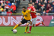 Joao Moutinho (28) of Wolverhampton Wanderers is challenged by Jamie Paterson (20) of Bristol City during the The FA Cup 5th round match between Bristol City and Wolverhampton Wanderers at Ashton Gate, Bristol, England on 17 February 2019.